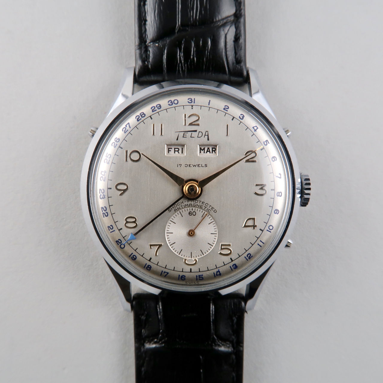 Telda circa 1950 | chrome & steel triple calendar wristwatch